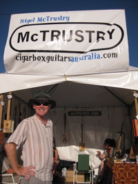 Nigel McTrustry at the Byron Bay Bluesfest with his cigar box guitars