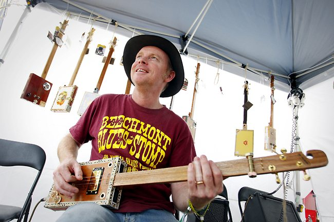 The Gympie Muster and Nigel McTrustry with his cigar box guitars
