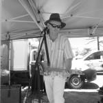 Playing the cigar box guitar blues at the Kirra Kite Festival