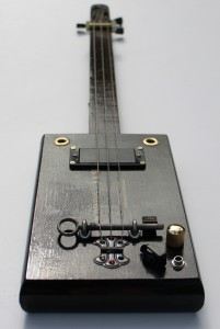 'Back in Black' cigar box guitar with Humbucker pick up and African Rosewood (Wenge) neck